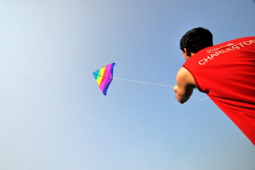 Flying a kite over the marsh