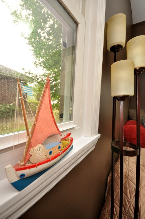 Painted toy sailboat